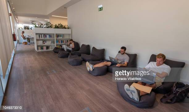 Students use their laptops while laying down in the library at NOVA School of Business and Economics new campus on October 04 2018 in Carcavelos...