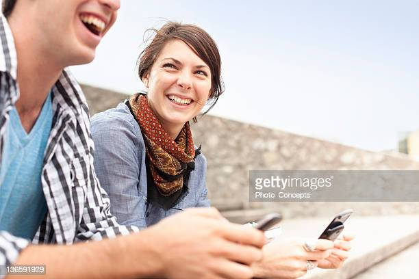students using cell phones on steps - peterborough ontario stock photos and pictures