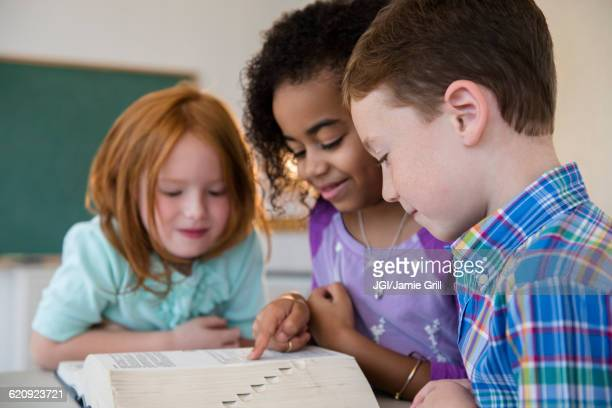 Students using dictionary in classroom