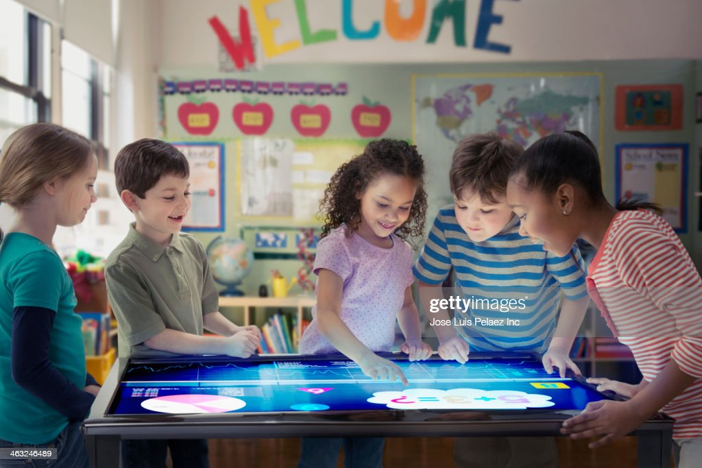 Students using digital tablet in classroom : Stock Photo