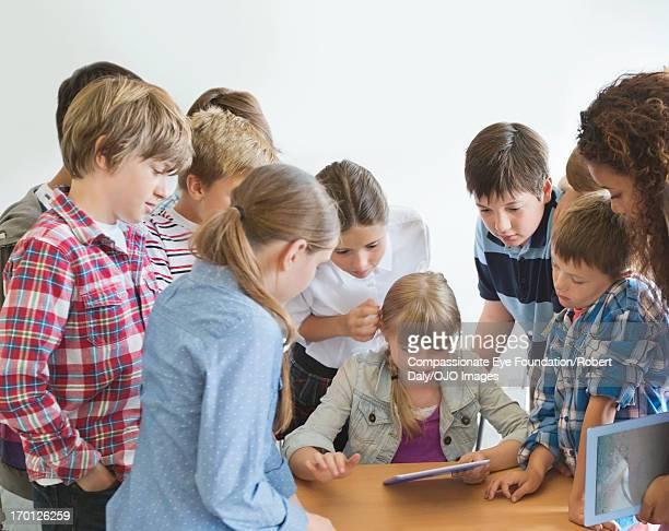 Students using digital tablet