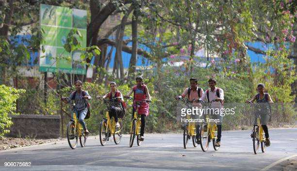 Students using OFO Cycles at SPPU Campus on January 16 2018 in Pune India Chinese bicycle sharing service Ofo has launched its service in seven...