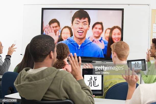 students using video conference in class - korean ethnicity stock pictures, royalty-free photos & images