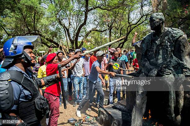 Students vandalise the statue of Charles Robberts Swart on February 23 2016 at the University of Free State in Bloemfontein South Africa Students at...