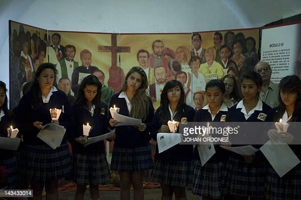 Students visit the crypt of Monsignor Juan Jose Gerardi in Guatemala's Metropolitan Cathedral on April 26 2012 in Guatemala City Gerardi was...
