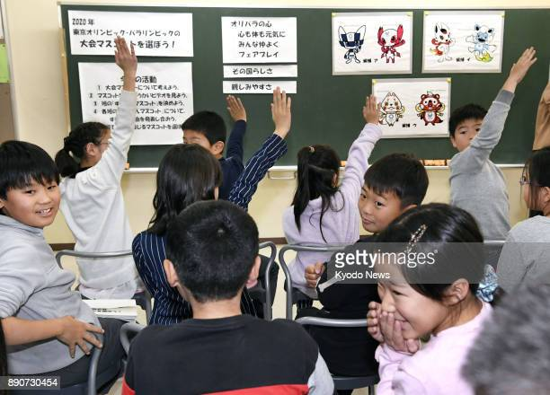 Students vote at an elementary school in Tokyo on Dec 11 to select which of the three pairs of candidate characters will become the official mascots...