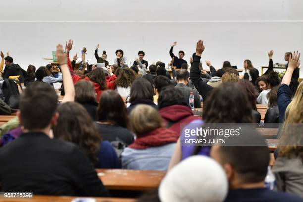TOPSHOT Students vote during a general assembly in Nanterre University west of Paris on May 15 a week after having voted an unlimited blockage of...