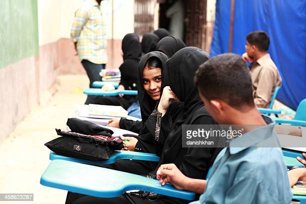 Students wait for class to start in Street School