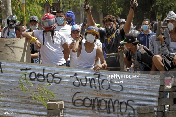 Students wait for riot police agents in a barricade close to Nicaragua's Technical College during protests against government's reforms in the...