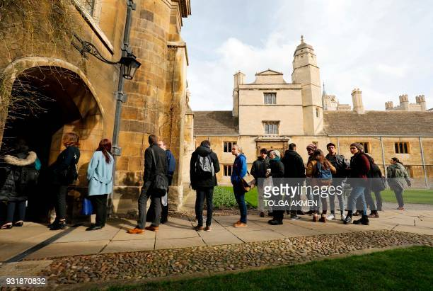 Students wait in line to sign a book of condolence opened at Gonville and Caius College where British physicist Stephen Hawking was a fellow for over...