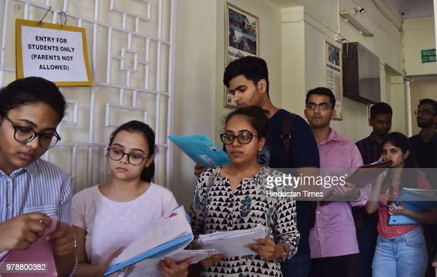 Delhi university aspirants stand in long queue to get admission for the new academic session 201819 at Hindu College on June 19 2018 in New Delhi...