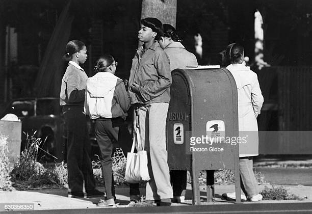 Students wait in vain along Blue Hill Avenue in Boston for school buses to pick them up on Oct 9 1980 An initiative to desegregate Boston Public...