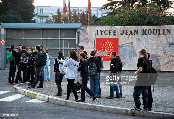 Students wait outside the Jean Moulin high school on October 17 2011 in Beziers southern France before a march in memory of Lyse Bonnafous who...
