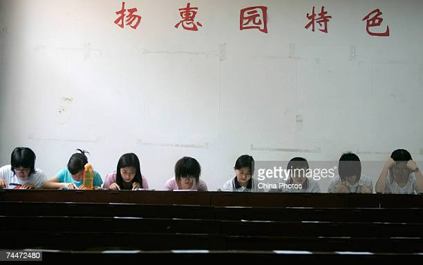 Students wait to attend a spoken English test part of the National College Entrance Examination at the University of International Business and...