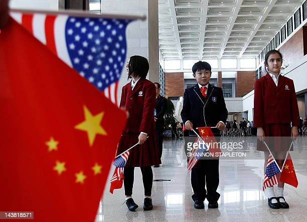 Students wait to greet US Secretary of State Hillary Clinton at the National Museum in Beijing on May 4 2012 US Secretary of State Hillary Clinton...