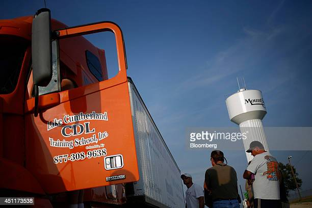 Students wait to operate a tractor trailer during a commercial drivers license class at Lake Cumberland CDL Training School in Mt Sterling Kentucky...