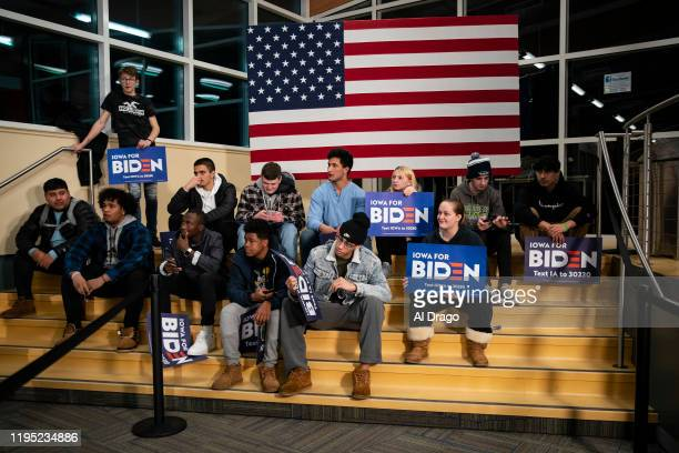 Students wait with campaign signage before posing for a photograph with Democratic presidential candidate, former Vice President Joe Biden during an...