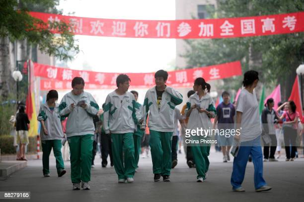 Students walk after sitting the National College Entrance Examination at an exam center on June 7 2009 in Beijing China About 102 million students...