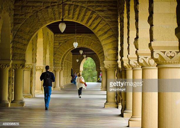 Students walk along covered footpath at Stanford University