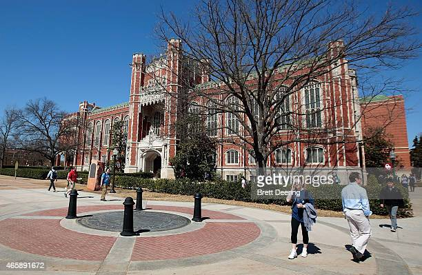 Students walk between classes in front of the Bizzell Memorial Library at the University of Oklahoma on March 11 2015 in Norman Oklahoma Video...
