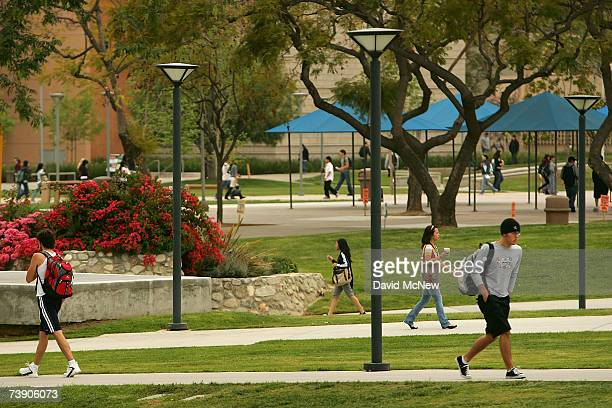 Students walk between classes near the site where the seven people were killed by a gunman on July 12, 1976 inside the California State University,...