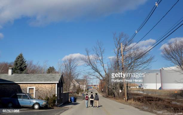Students walk home from school down Elm Street in the Pleasantdale neighborhood