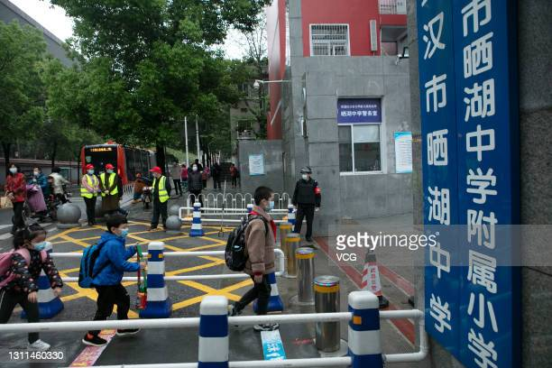 Students walk into the campus on April 8, 2021 in Wuhan, Hubei Province of China. Wuhan marks the one year anniversary of its lifting of lockdown on...