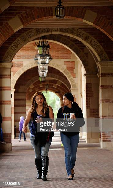 Students walk near Royce Hall on the campus of UCLA on April 23 2012 in Los Angeles California According to reports half of recent college graduates...