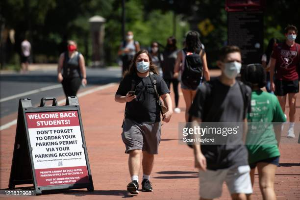 Students walk on campus at the University of South Carolina on September 3, 2020 in Columbia, South Carolina. During the final week of August, the...