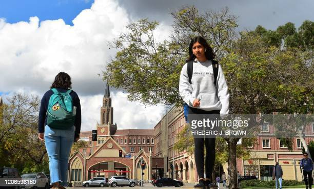 Students walk on the campus at the University of Southern California in Los Angeles California on March 11 where a number of southern California...