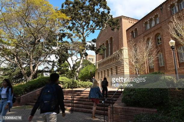 Students walk on the campus of University of California at Los Angeles in Los Angeles, California on March 11, 2020. - Starting this week many...