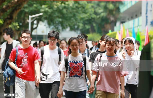 Students walk out of an exam site after finishing their first subject for the 2019 National College Entrance Examination at Nanjing No.9 High School...