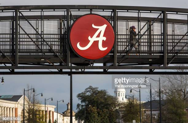 Students walk over a footbridge connecting new residential buildings with the older part of campus at the University of Alabama in Tuscaloosa AL...
