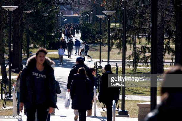Students walk over the campus as Beto ORourke makes a campaign stop at the Penn State University campus in State College PA on March 19 2019 The...