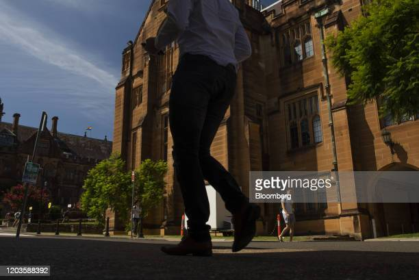 Students walk past a building at the University of Sydney in Sydney, Australia, on Tuesday, Feb. 25, 2020. The coronavirus hit has exposed the...