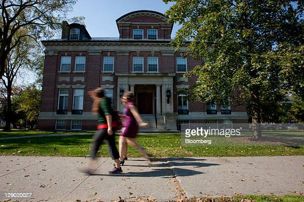 Students walk past an administration building on the Dartmouth College campus the day before a Republican presidential debate sponsored by Bloomberg...