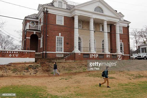 Students walk past the Phi Kappa Psi fraternity house on the University of Virginia campus on December 6 2014 in Charlottesville Virginia On Friday...