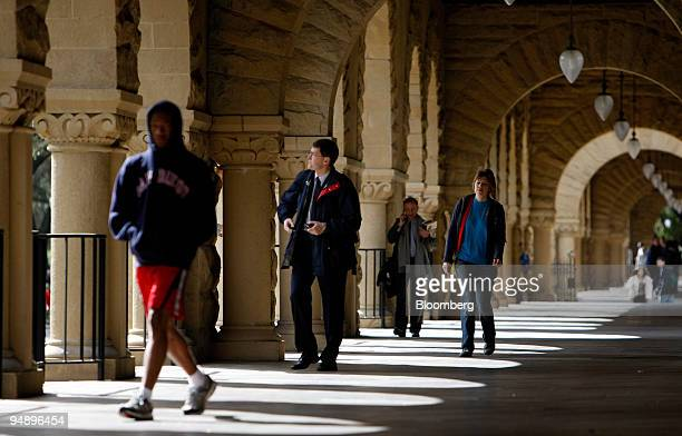 Students walk through an open corridor on the Stanford University campus in Palo Alto California US on Wednesday Feb 20 2008 Stanford University...