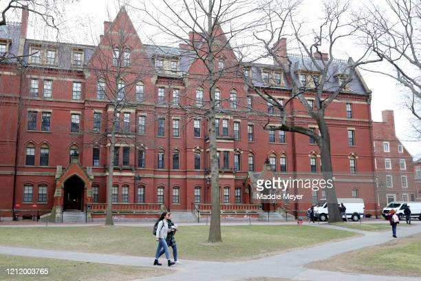 Students walk through Harvard Yard on the campus of Harvard University on March 12 2020 in Cambridge Massachusetts Students have been asked to move...