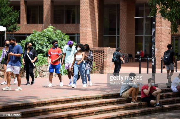 Students walk through the campus of the University of North Carolina at Chapel Hill on August 18, 2020 in Chapel Hill, North Carolina.The school...