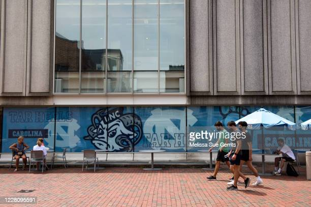 Students walk through the campus of the University of North Carolina at Chapel Hill on August 18 2020 in Chapel Hill North Carolina The school halted...