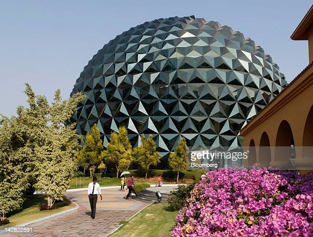 Students walk through the Infosys Ltd Global Education Centre campus in Mysore India on Monday Feb 20 2012 Infosys's Global Education Centre or GEC...