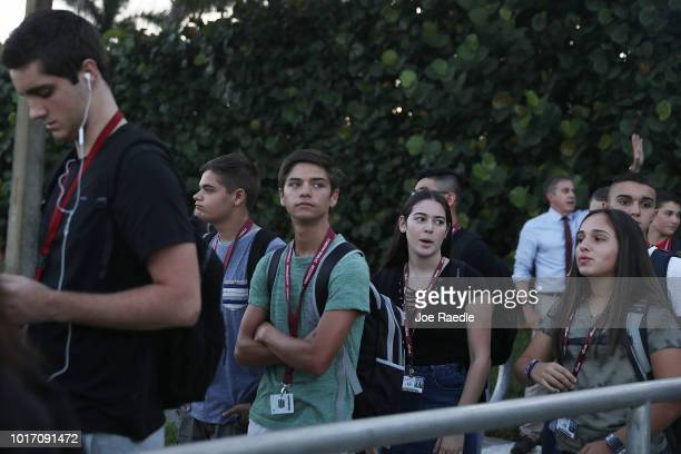 Students walk to Marjory Stoneman Douglas High School on the first day of school on August 15 2018 in Parkland Florida Former student Nikolas Cruz is...