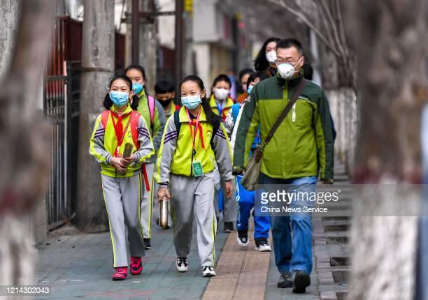 Students walk to school amid the coronavirus outbreak on March 23 2020 in Urumqi Xinjiang Uygur Autonomous Region of China