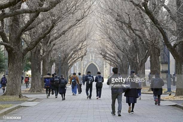 Students walk to the venue of their entrance exams at the University of Tokyo on Jan. 16, 2021. Japan's new unified university entrance exams started...