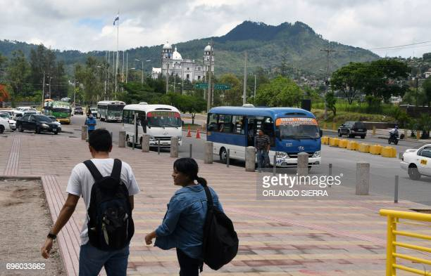 Students walk towards a bus station in Tegucigalpa on June 14 2017 Public transport workers and passengers in this Central American country have been...