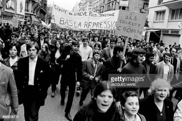 Students walk under the banner 'Down with repression' during the demonstration of May 13 1968 in Paris Demonstrator march 13 May 1968 in Paris at the...