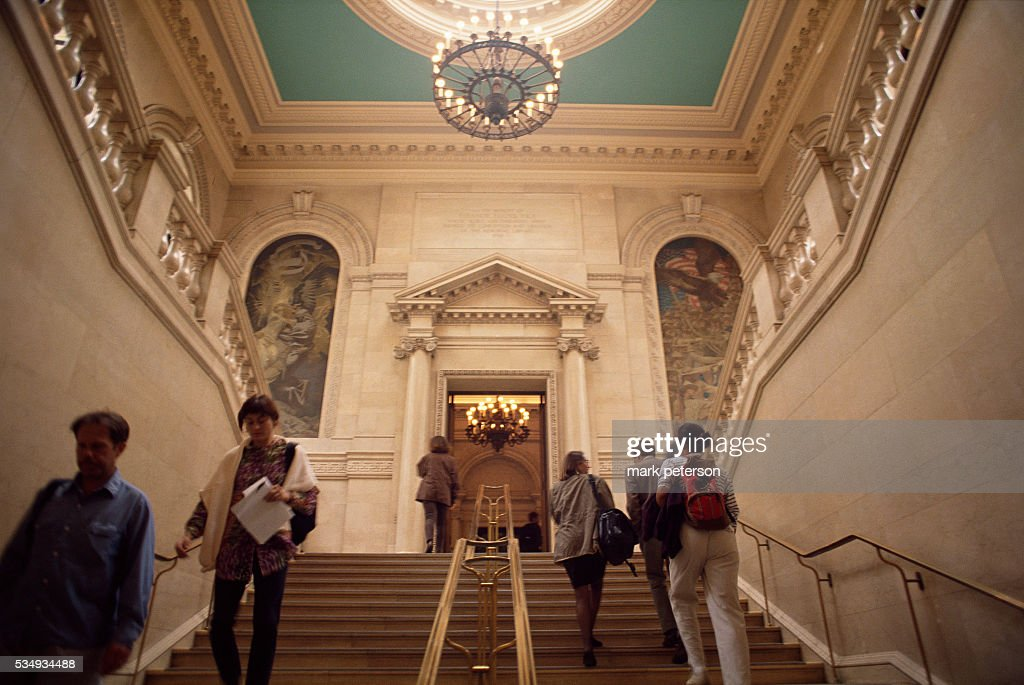 Students Walk Up Widener Library Staircase At Harvard University