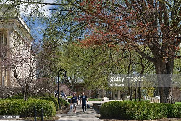 students walking in campus - state college pennsylvania stock pictures, royalty-free photos & images