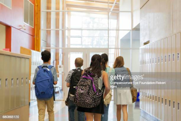 Students walking in corridor
